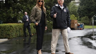 Меланија Трамп низ поплавените подрачја прошета како на модна писта