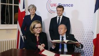 Меј и Макрон потпишаа договор за решавање на проблемот со мигрантите во Кале